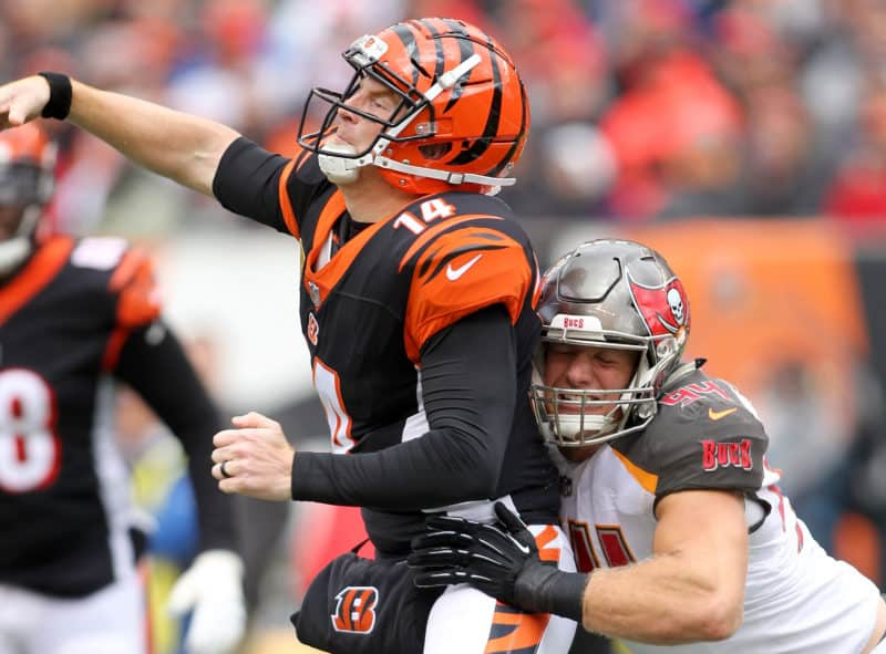 Andy Dalton gets hit by Carl Nassib while attempting a pass