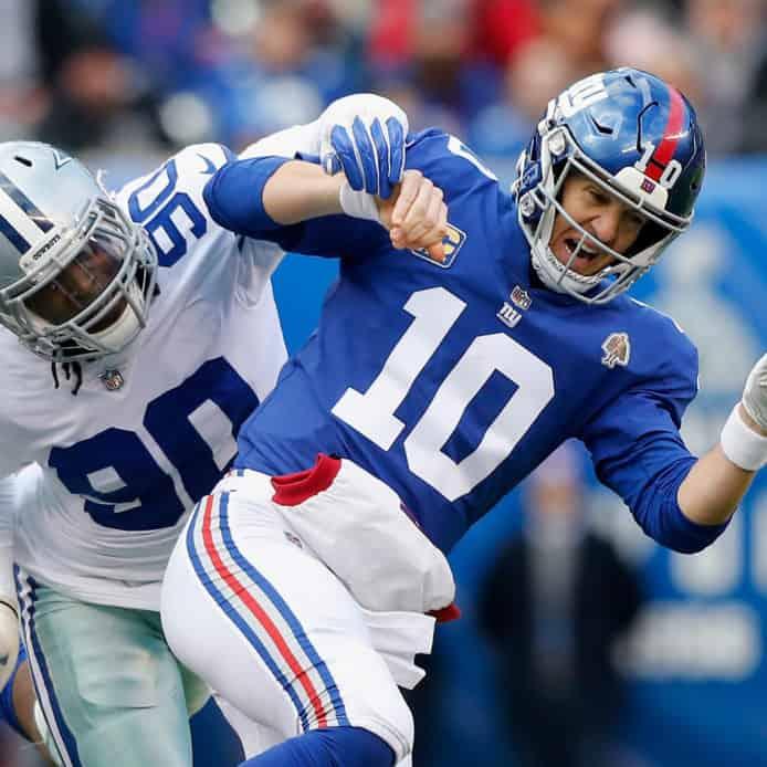 Giants QB Eli Manning gets hit by Cowboys DE Demarcus Lawrence