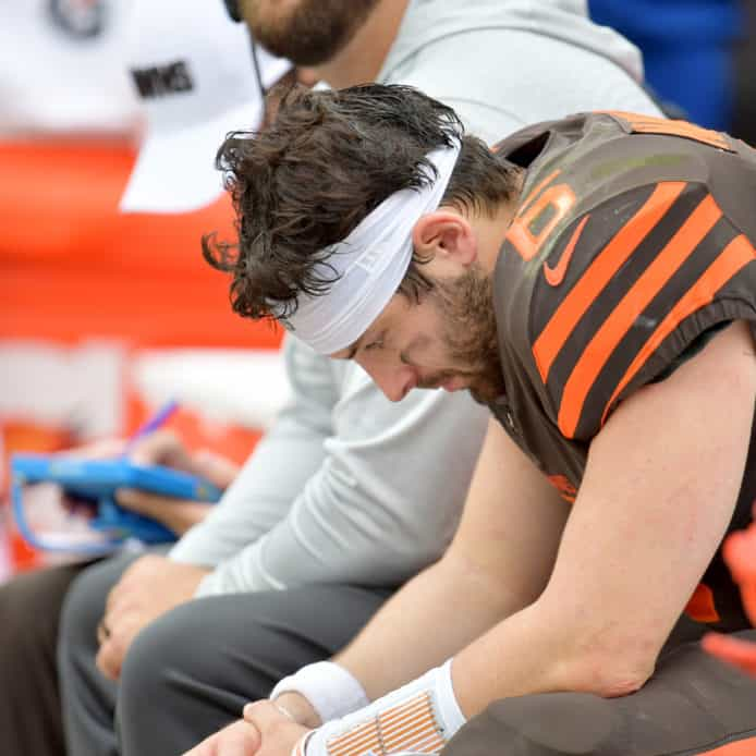Baker Mayfield sits on the bench